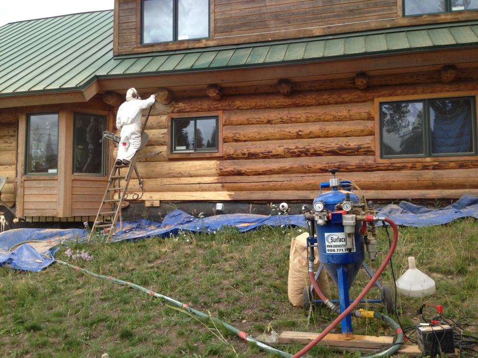 removing old finish from log home cabin
